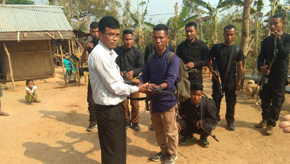 Garo National Liberation Army operatives  surrendering before a church elder in East Garo Hills district.(HT Photo)