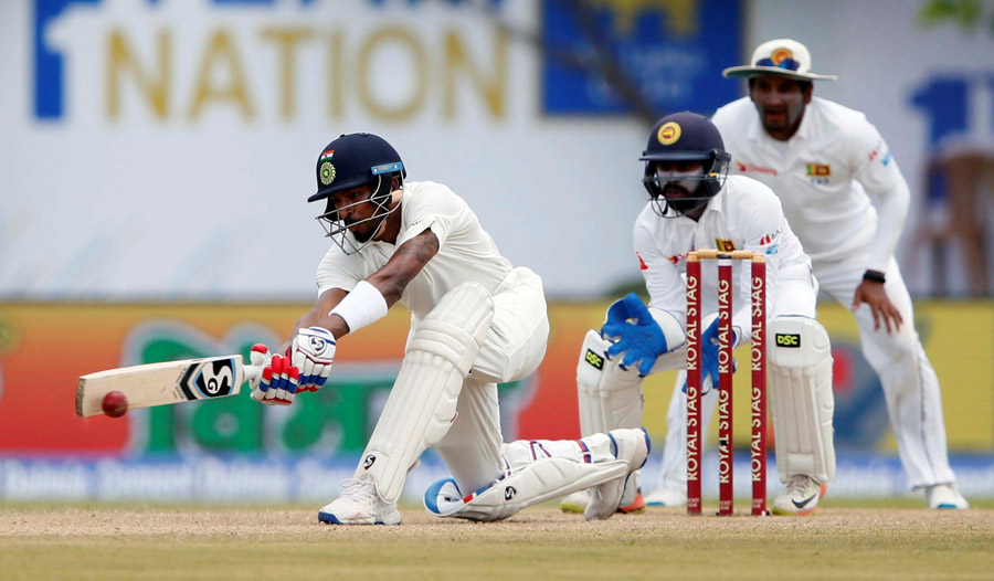 Pandya sweeps en route his debut half-century. (Image credit: Dinuka Liyanawatte/Reuters)