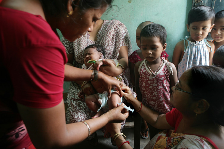 Administering the hepatitis B vaccine to a child at a rural health center in India.  United Nations Development Programme, CC BY-NC-ND