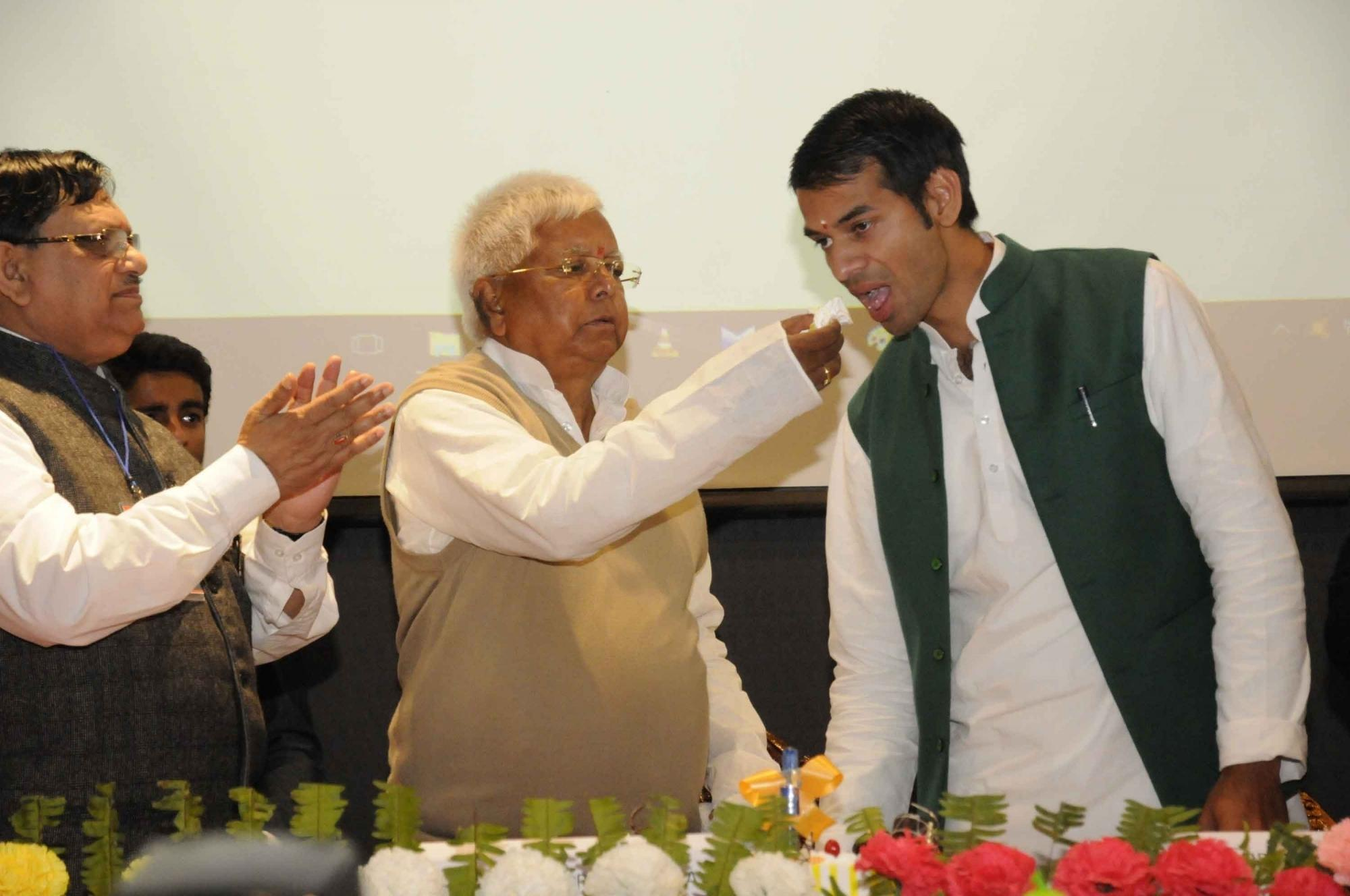 Rashtriya Janata Dal chief Lalu Prasad Yadav and Bihar Health Minister Tej Pratap Yadav during a programme at Indira Gandhi Institute of Medical Sciences in Patna. Photo Credit: IANS