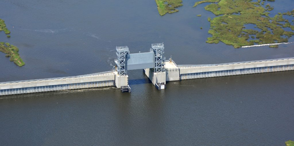 A gate is opened on a new storm surge barrier outside New Orleans. Storm surge barriers are one example of engineering solutions for urban resilience. Photo credit: US Army Corps of Engineers