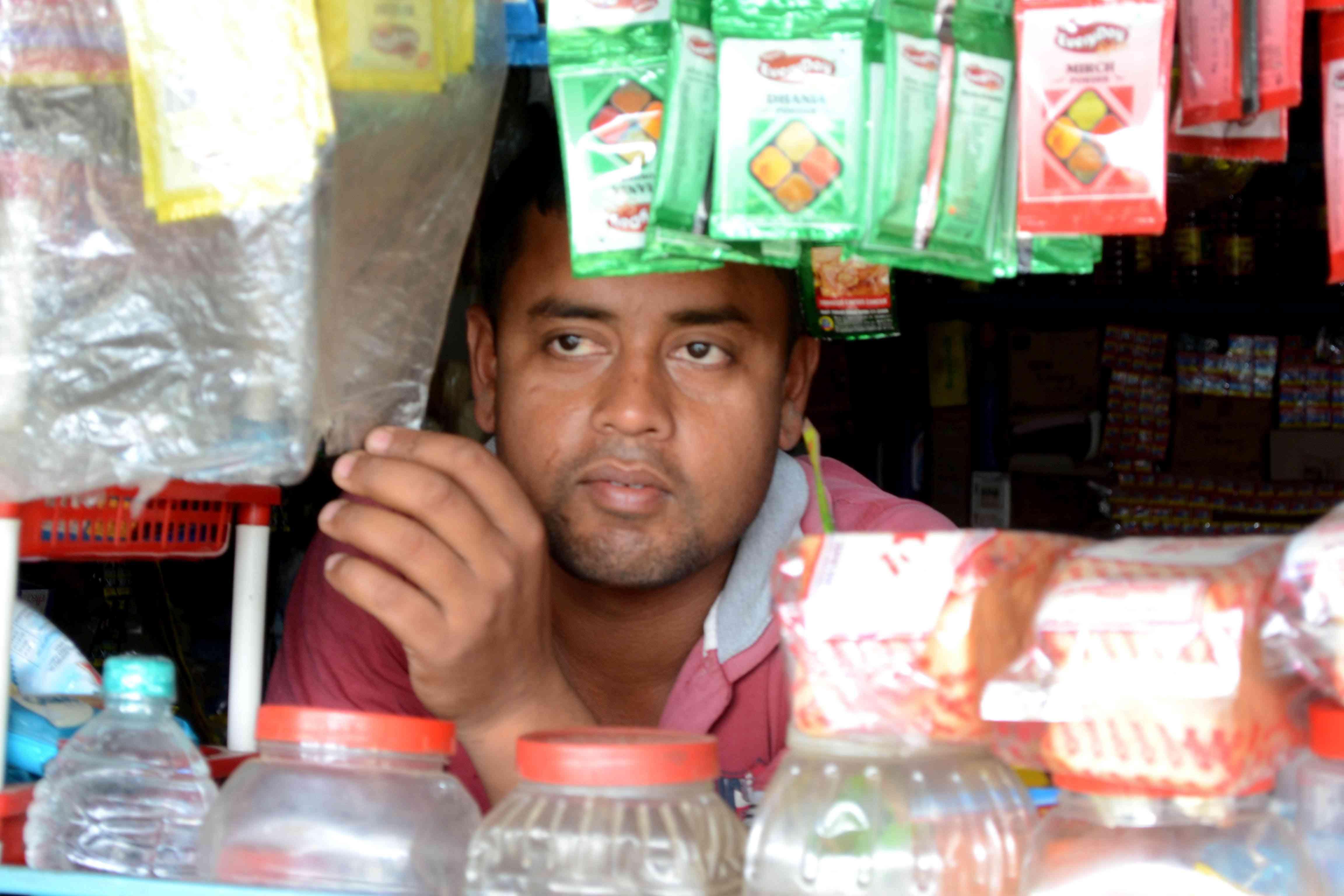 Moina Dutta runs a grocery shop in Lakhimpur. Photo credit: Anupam Chakravartty