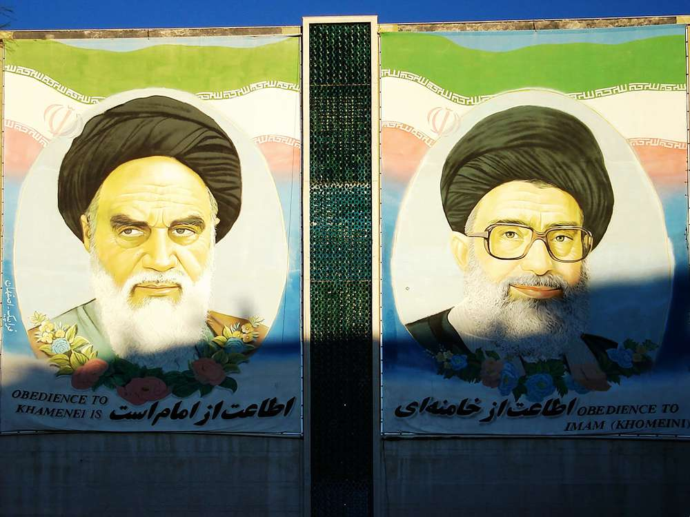 In contrast to the modern bustle, Iran's religious leadership remains ubiquitous. Paintings of Ayatollah Ali Khamenei, Iran's supreme leader, left, and Ruhollah Khomeini, founder of the Islamic republic of Iran, on the wall of a government office in Tehran.
