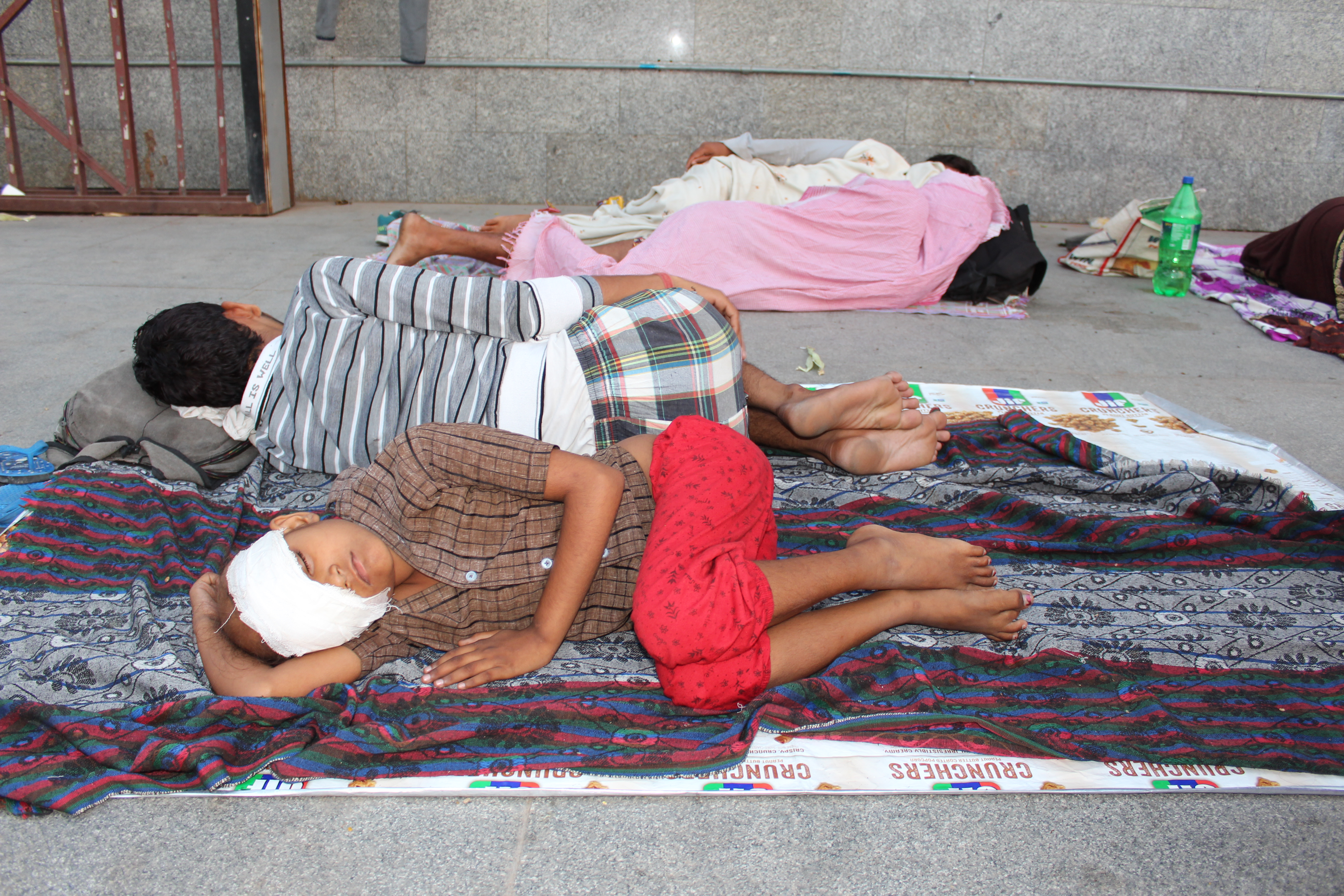 Nine-year-old Mohini who has cancer in her right eye, has been sleeping with her uncle and grandmother outside a metro station near the All India Institute of Medical Sciences. (Photo: Ankur Paliwal)