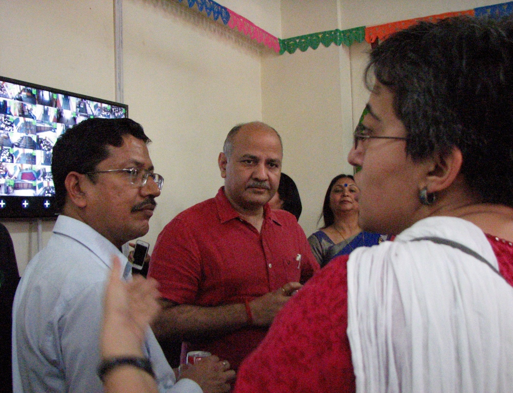 Delhi Education Minister Manish Sisodia, with his advisor Atishi Marlena, discusses CCTV footage being shown on a large screen from the various classrooms of the Government Boys Senior Secondary School, Shahbad Daulatpur, North Delhi. (Photo credit: Aparna Kalra)