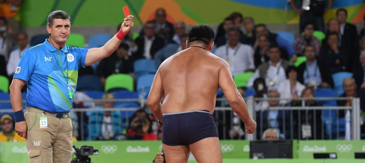 Michael Phelps's death stare, Mongolian coach strip-protest were among the strangest moments of Rio