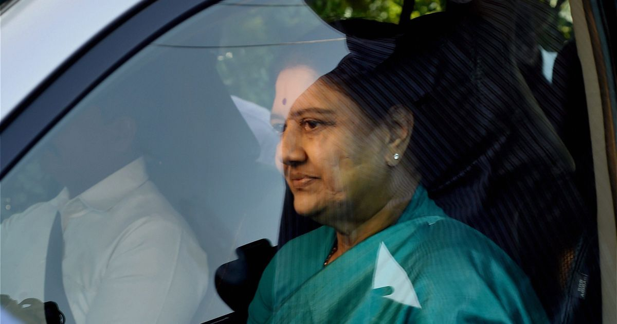 VK Sasikala returns to poll-bound Tamil Nadu in vehicle carrying AIADMK flag