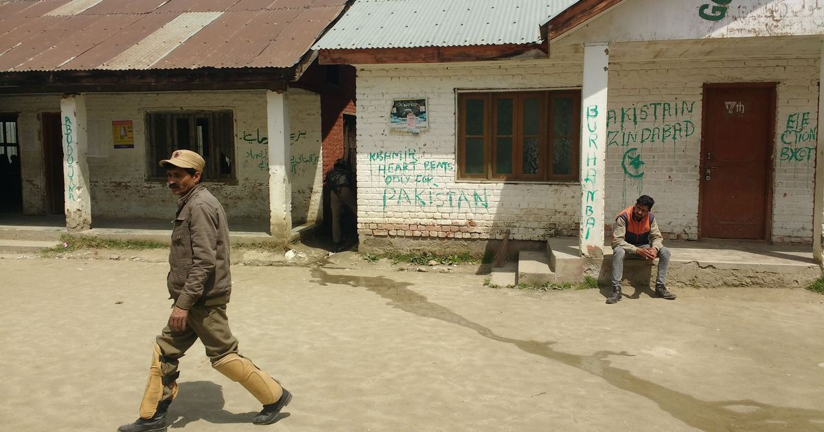 Polling booth walls covered with pro-Pakistan slogans in Kashmir's Budgam district. Image credit: Rayan Naqash