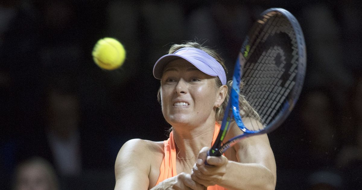 Bouchard beats Sharapova at Madrid Open