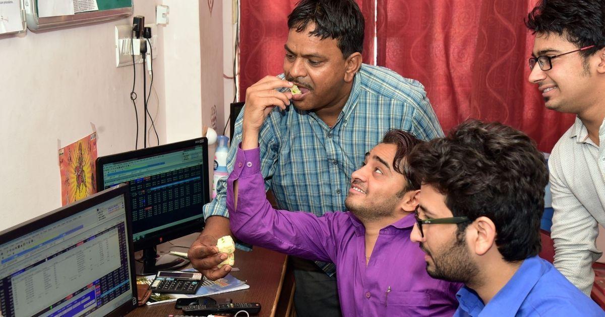 Markets close at record high, Nifty falls short of 10,000-mark