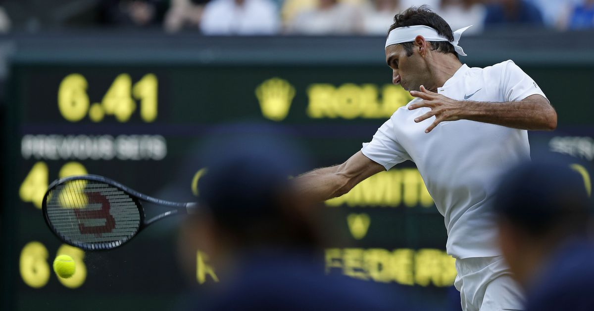 Federer reaches semi-final