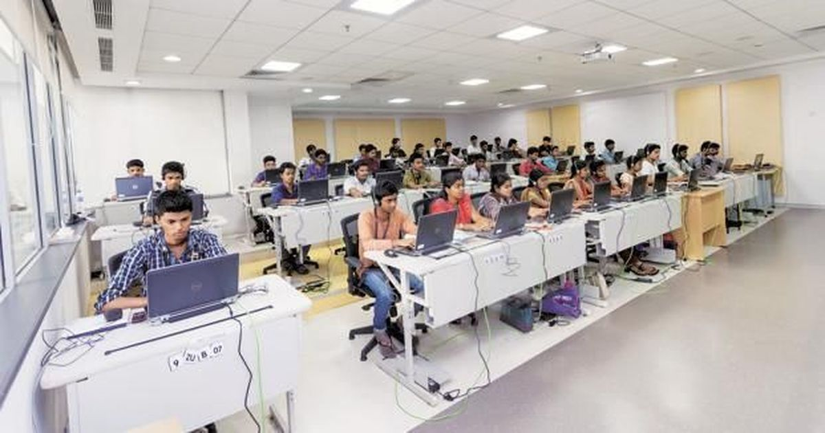 An Indian IT firm hires high-school graduates and turns them into software programmers