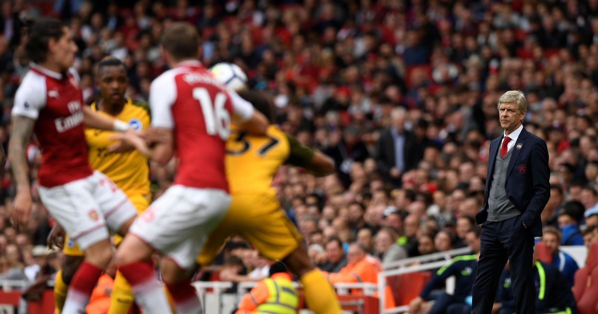 Premier League: Arsene Wenger savours 21st anniversary as Arsenal sink Brighton