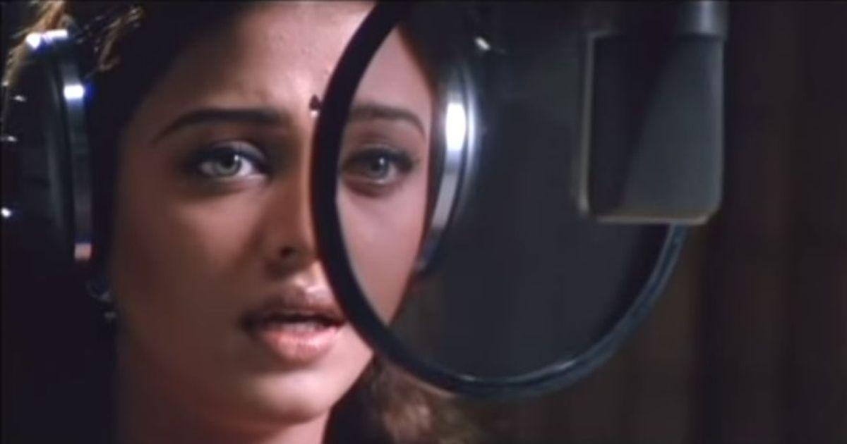 Picture the song: Tears in the rain in 'Enge Enadhu Kavithai' from 'Kandukondain Kandukondain'