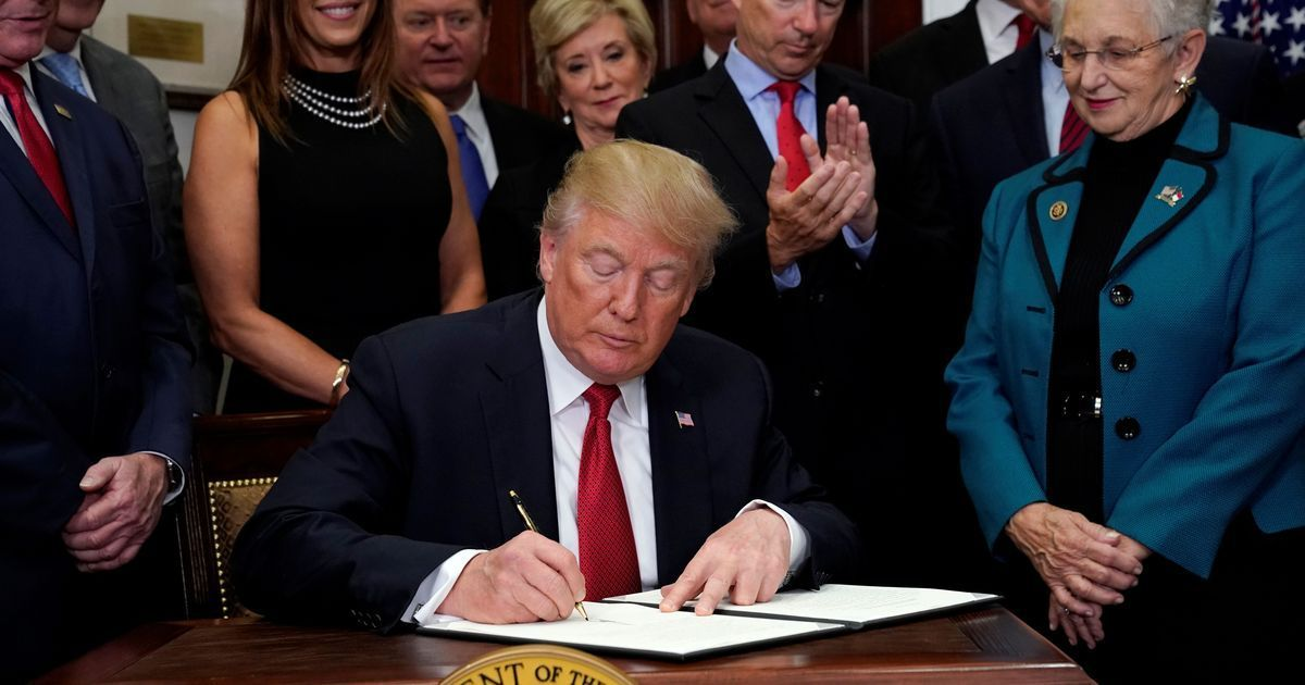 US President Donald Trump signs order to weaken Obamacare
