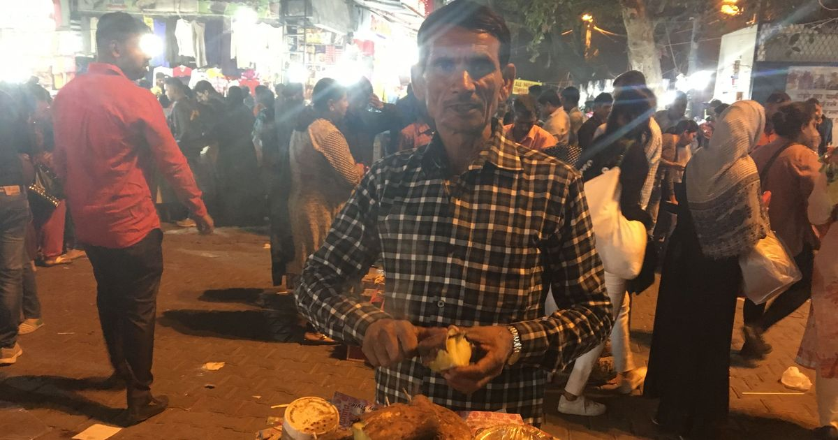 'I feel better only when I go to my village': This street hawker is sick of Delhi's polluted air