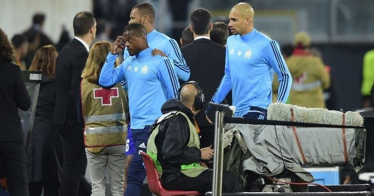 Patrice Evra faces possible sacking by Marseille and heavy sanctions by Uefa for 'karate kick'