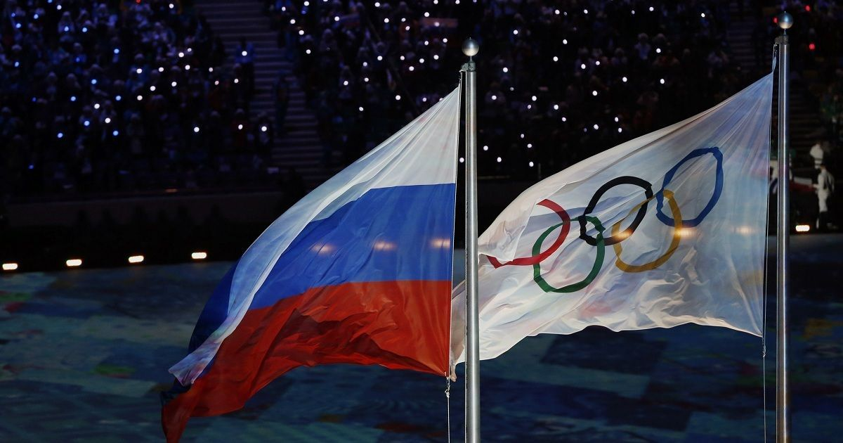 Russia banned from 2018 Winter Games but athletes can compete under Olympic flag