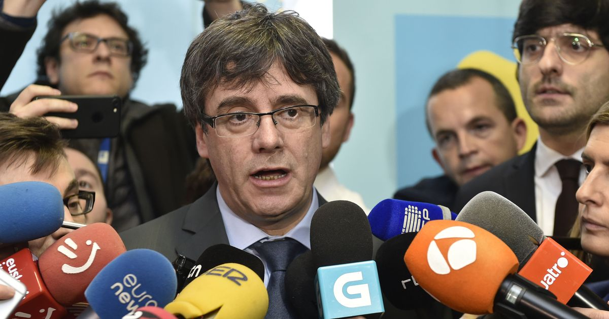 Spanish court suspends Puigdemont's return to power in