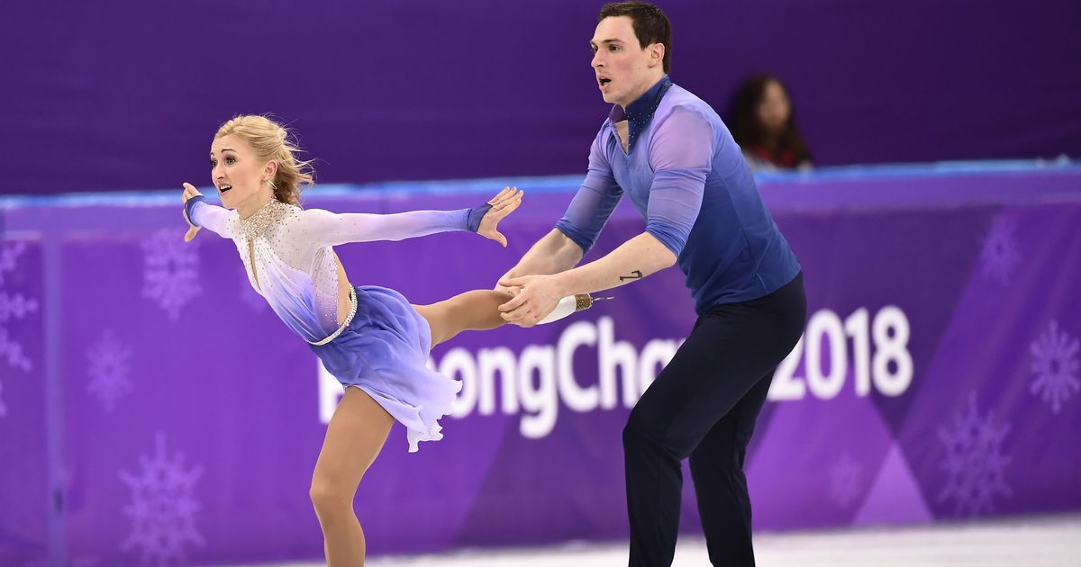 Record-setting Savchenko-Massot win emotional pairs skating gold