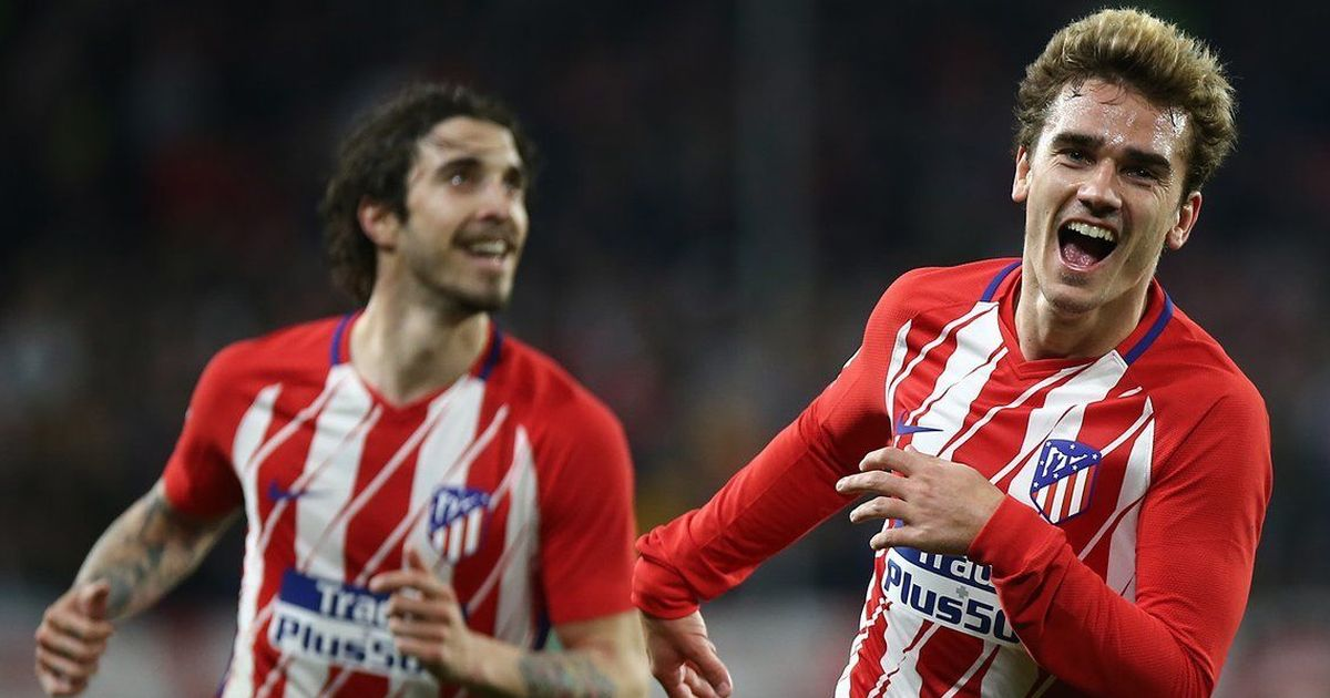 Atletico keep Barcelona in La Liga sight