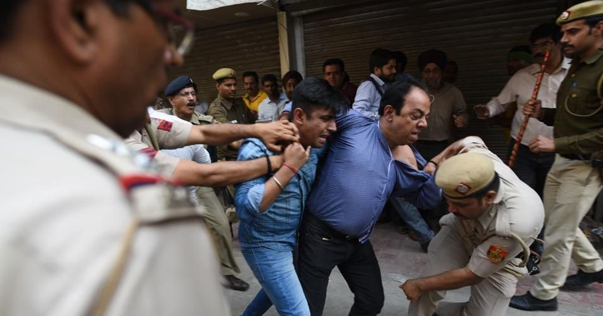Delhi sealing drive: Photojournalist accuses police of manhandling him