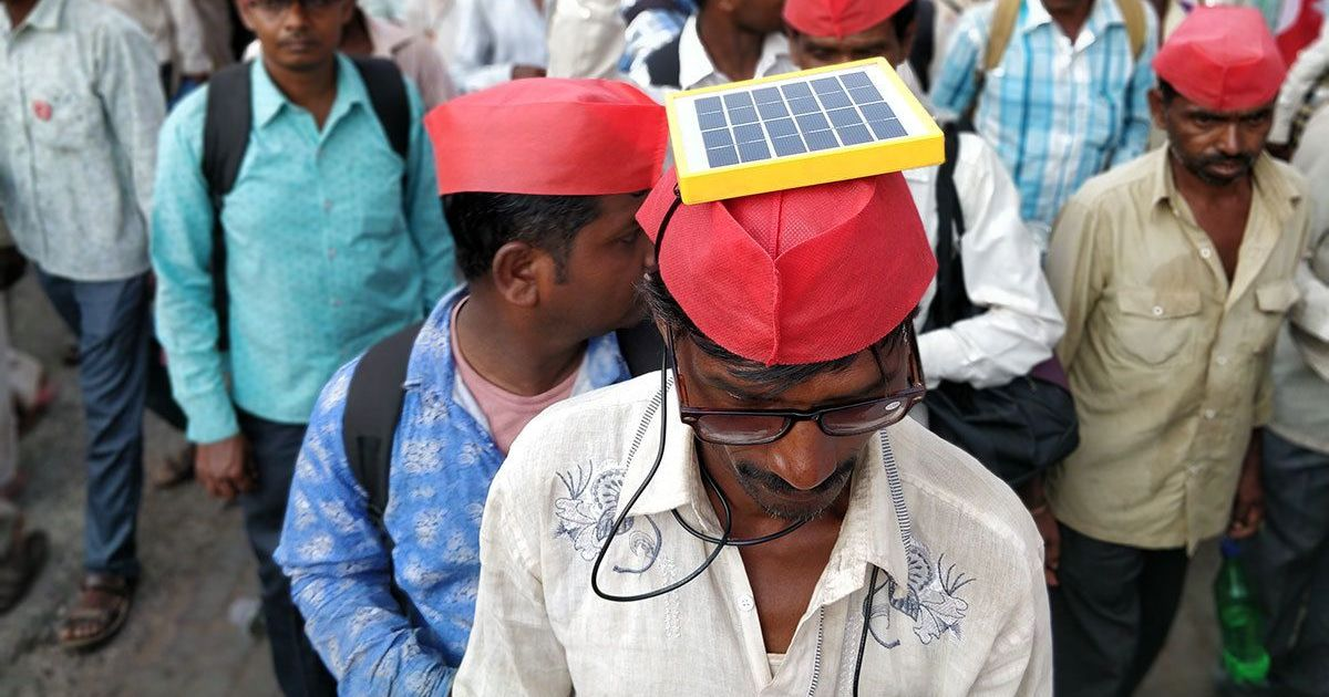 Photos: The Long March under the blazing sun left farmers drained – but kept their mobiles charged
