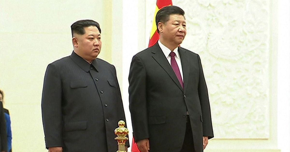Kim Jong-un meets Xi Jinping in China, commits to denuclearisation of North Korea