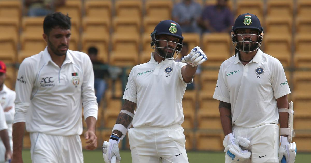 Afghanistan bowlers keep India in check even as Vijay, Dhawan smash tons on rain-hit Day 1