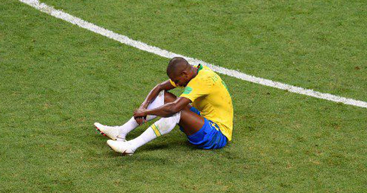 Brazil midfielder Fernandinho and family suffer racial abuse after own goal in World Cup quarters