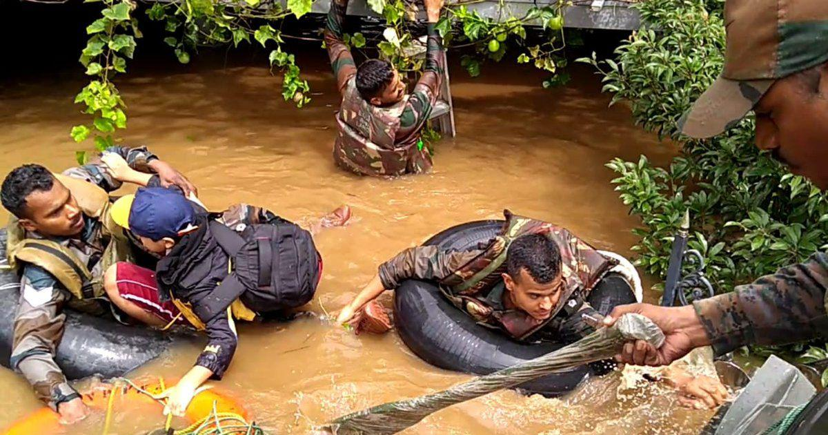 Image result for police in kerala floods time