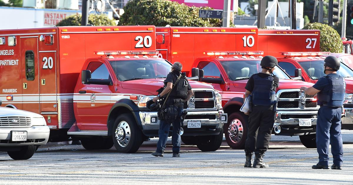 USA police surround barricaded armed suspect at Trader Joe's supermarket in California