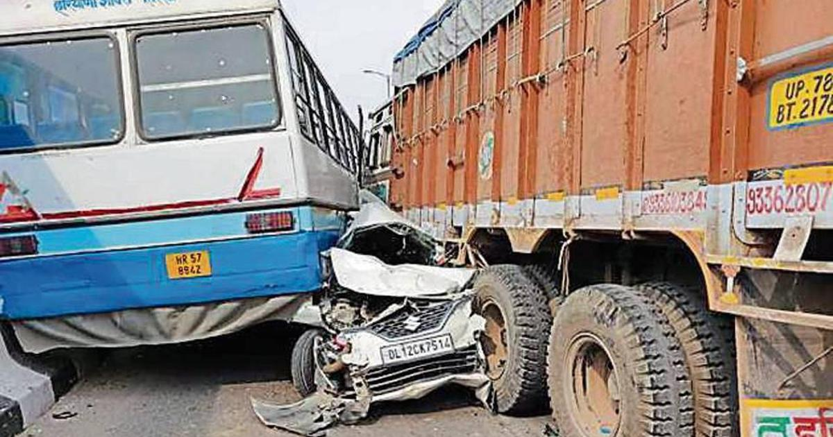 Delhi: Man escapes with injuries after his car gets crushed in bus-truck collision