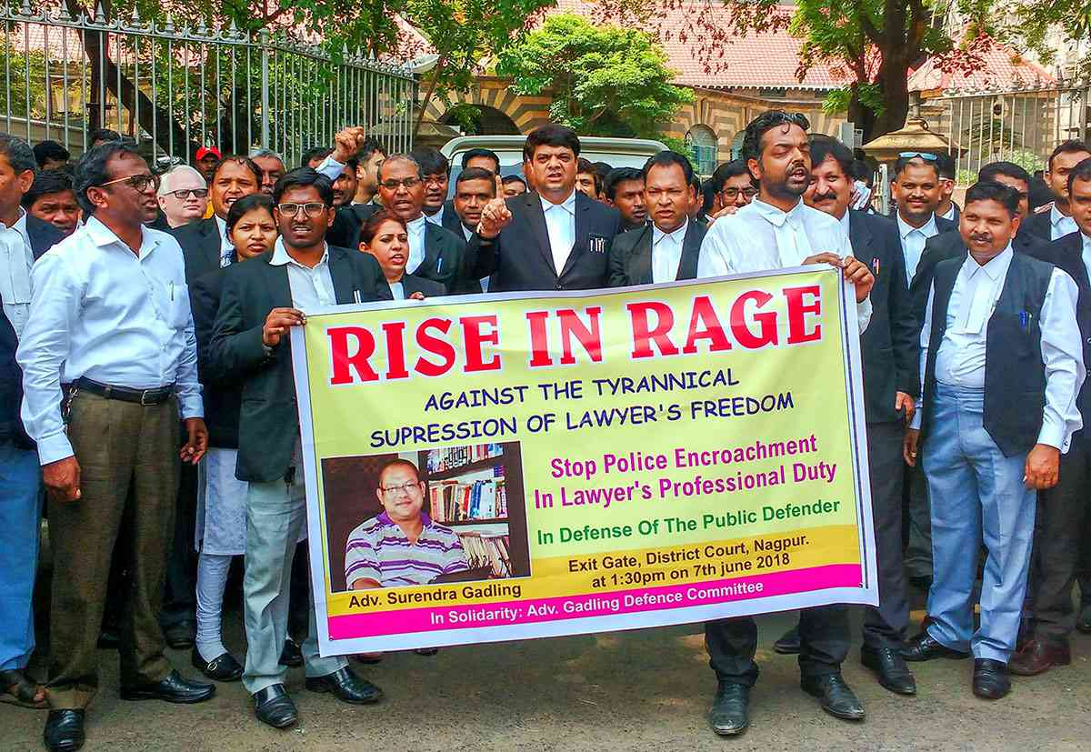Lawyers hold a banner during a silent march in support of advocate Surendra Gadling who was arrested by Pune police for his alleged links to the Bheema-Koregaon violence case, in Nagpur, on Thursday, June 7, 2018.