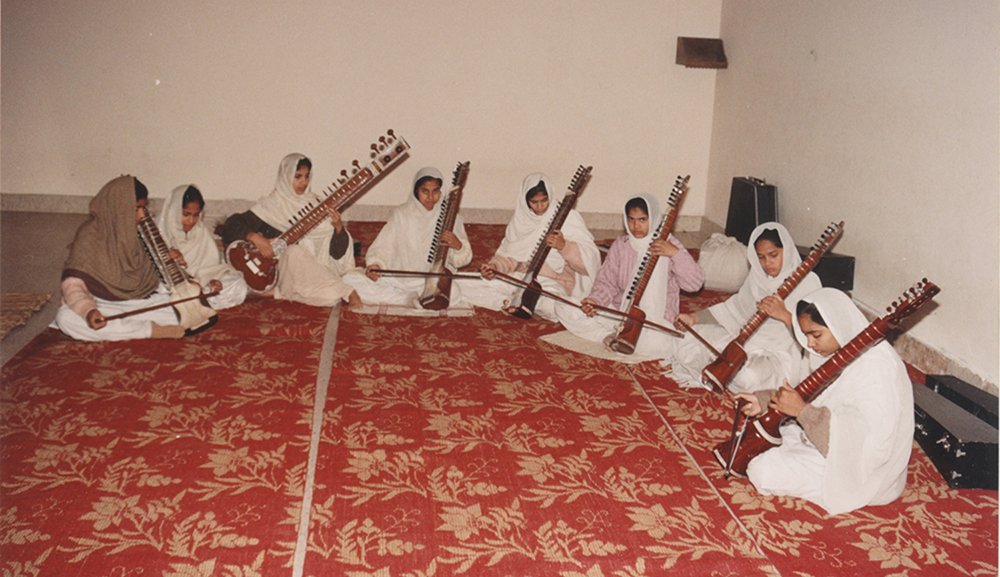 A class in progress, girls practising the dilruba . Image credit: V Dikshit