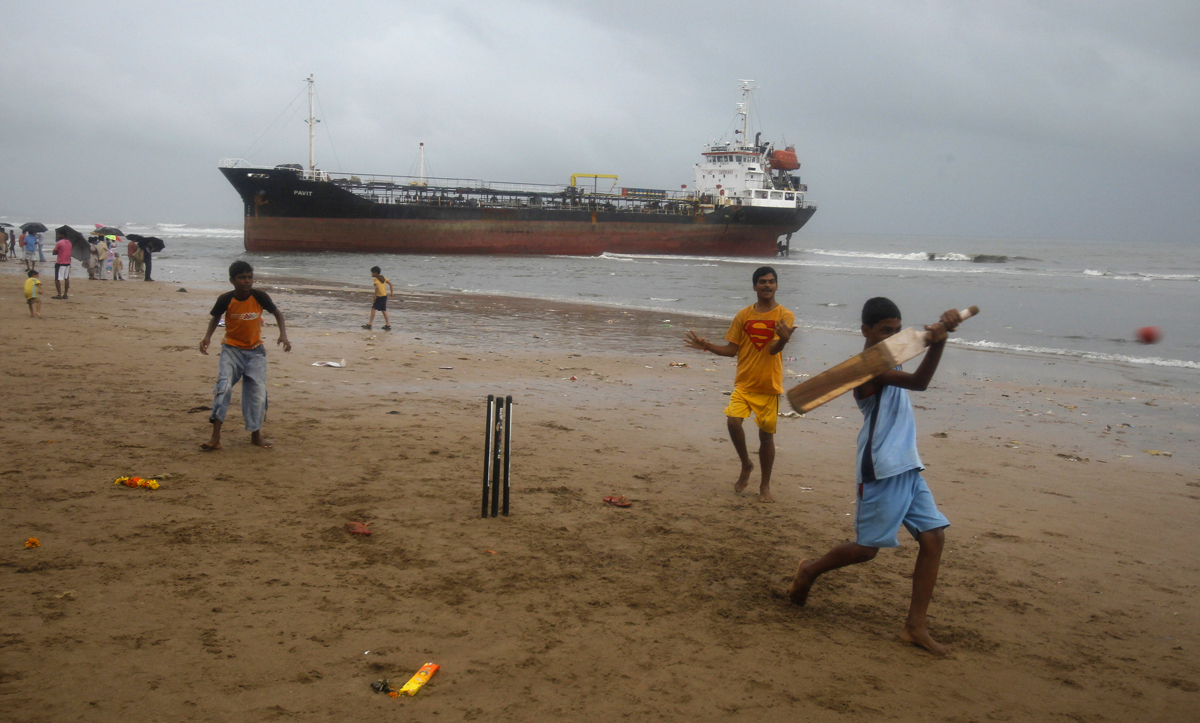 Children play cricket on Mumbai's Juhu Beach. Image credit: Vivek Prakash / Reuters