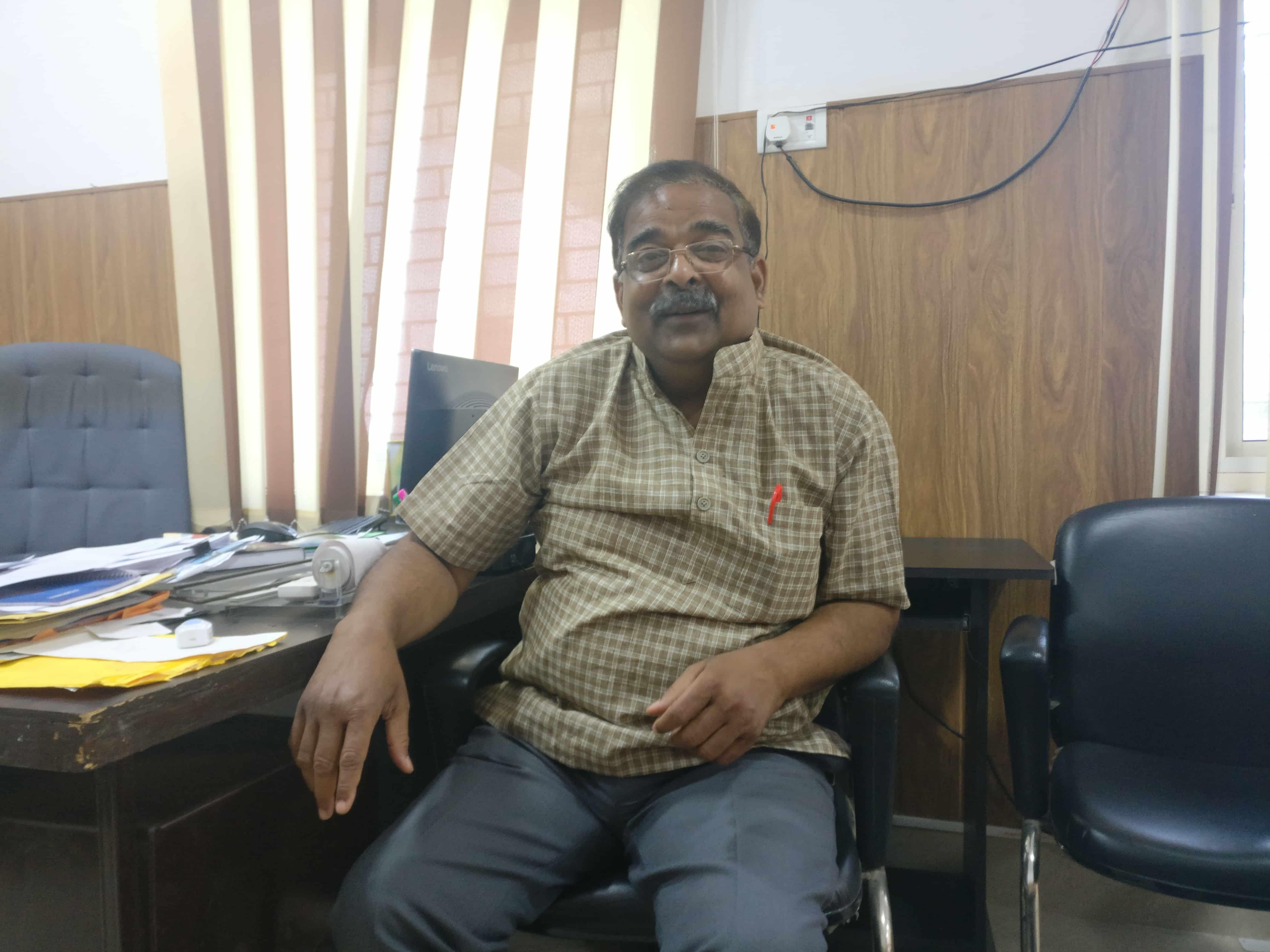 Ajay Bisaria, a seventh-generation resident of Aligarh, teaches Hindi at the Aligarh Muslim University. Photo credit: Shreya Roy Chowdhury