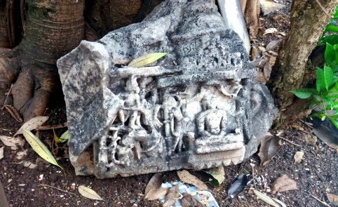 A Jain temple fragment, around 800 years old, lies discarded at the base of a tree behind a temple in Thane. Photo: Aarefa Johari