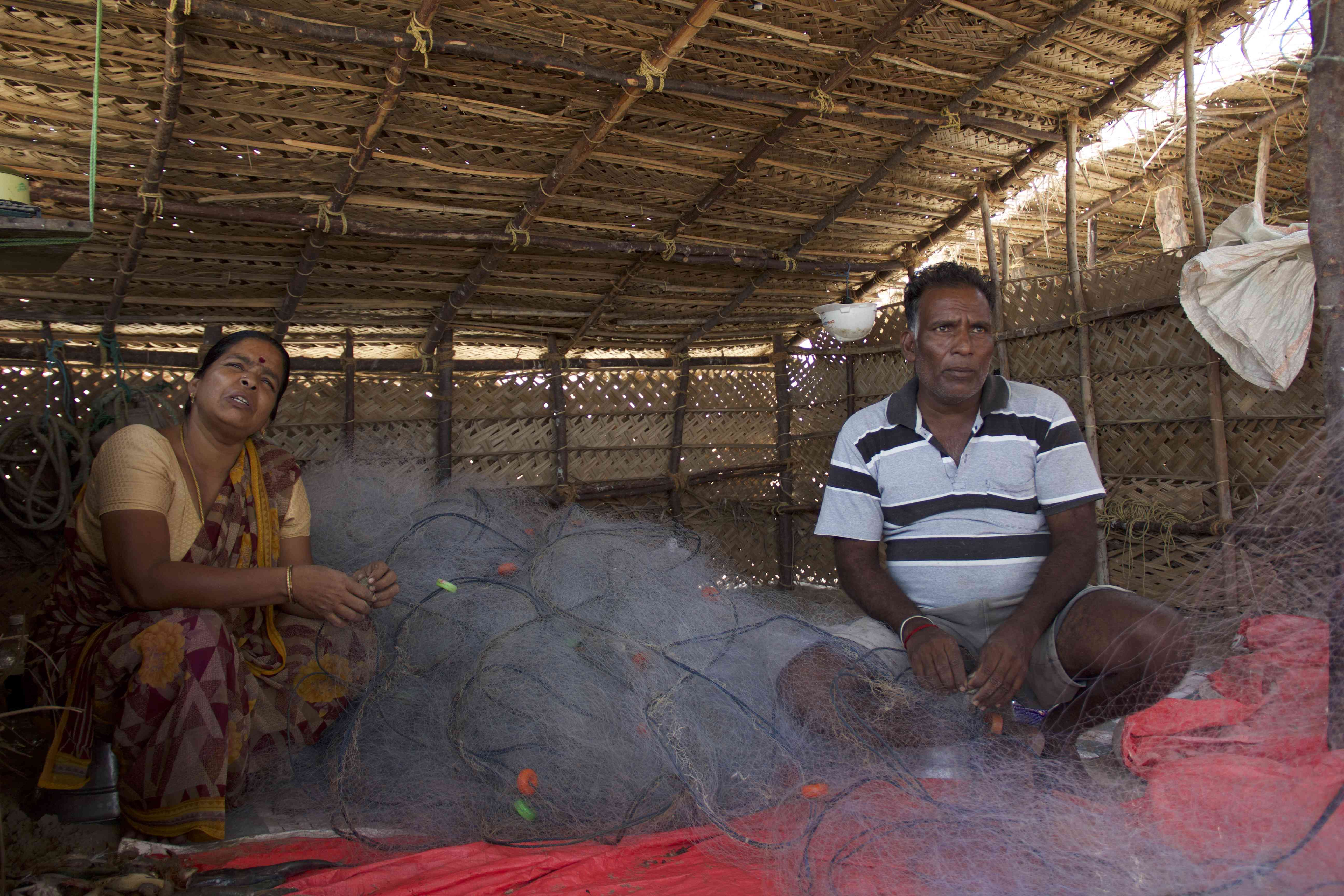 R Thennarasu and his wife, T Rani, squatted on the beach pick out fish and shrimps caught in the fishing net at Arucottuthurai fishing village in Nagapattinam district in Tamil Nadu. Photo credit: M Palanikumar/Pepcollective