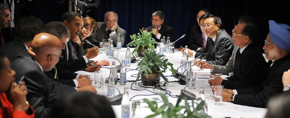 File photo: US President Barack Obama (centre, left) speaks during a meeting with Chinese Prime Minister Wen Jiabao (second, right), Indian Prime Minister Manmohan Singh (right) and other leaders at the Bella Centre in Copenhagen on December 18, 2009, on the 12th day of the COP15 UN Climate Change Conference. (Photo credit: Jewel Samad/AFP).