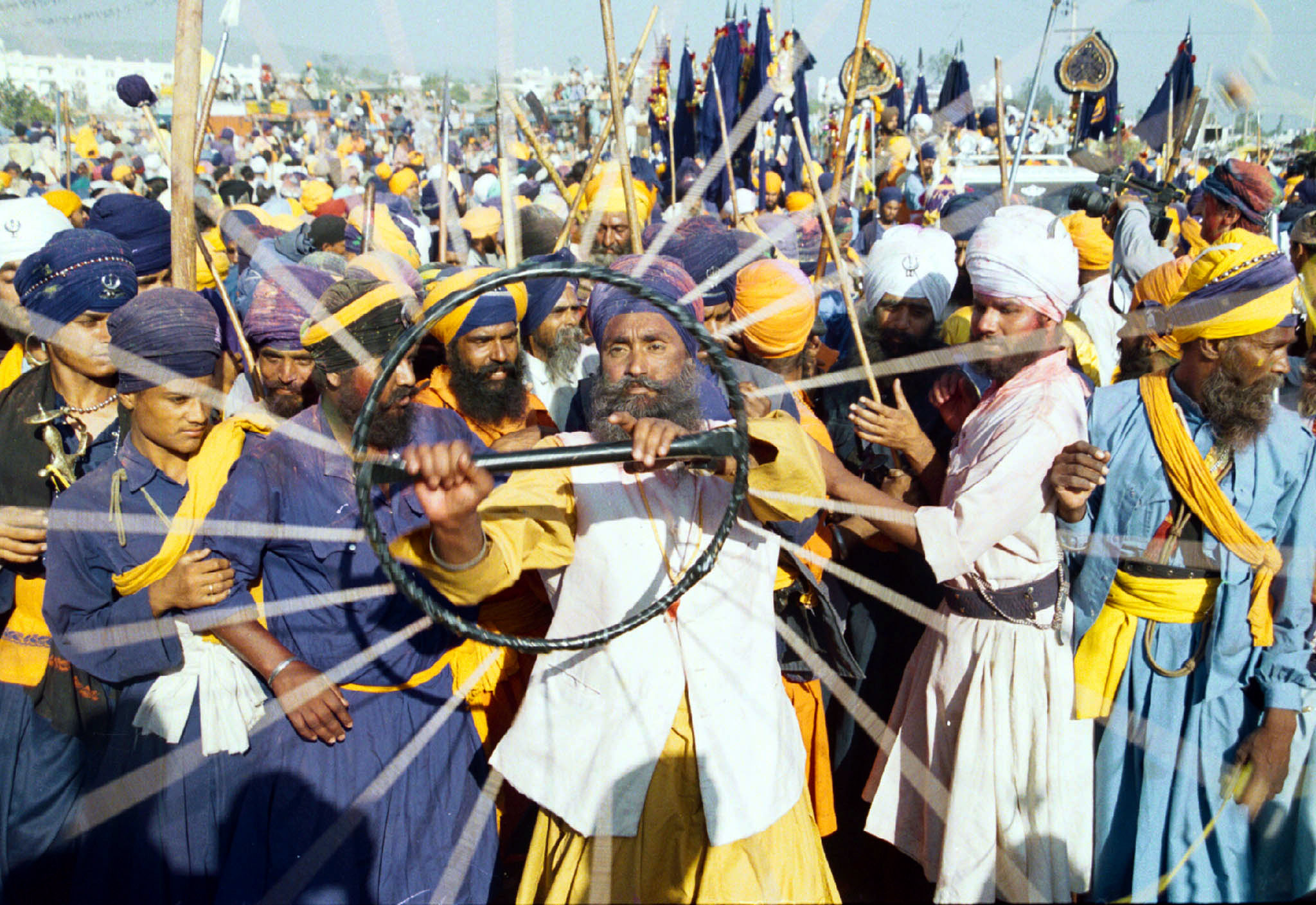 A Nihang Sikh plays Gatka or a pre-war exercise, while participating in