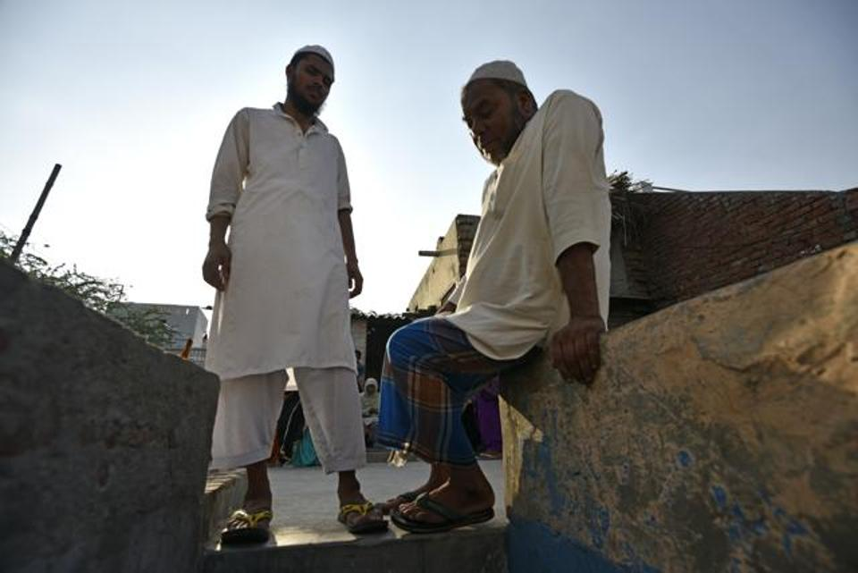 Junaid's brother Hashim, and his father, Jalaluddin. Photo credit: Ravi Choudhary/HT Photo