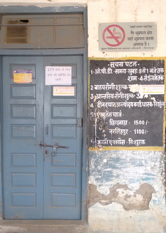 Notice on the door about closure of out-patient services on the day of the sterlisation camp at the community health centre in Harrai, Chhindwara. Photo: Nikhil Srivastav.
