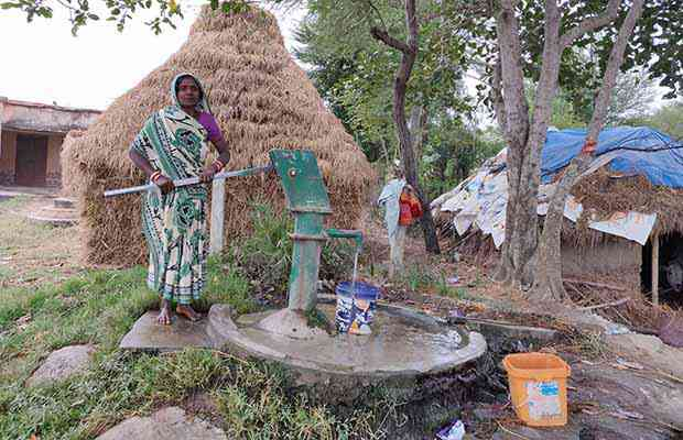 Kuntala Rout, 58, who lives in a village in Odisha's Bhadrak district along India's eastern coast, says the burden of filling water falls on women, and they spend nearly four hours every day getting water. Photo credit: Disha Shetty