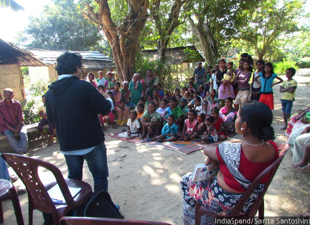 Arpana Choudhury, justice programme associate with Nazdeek, addresses a group of men, children and about 40 women in Narayanpur Tea Estate during a community meeting where women are educated about measures to take during pregnancy and informed about the rights that they are entitled to. Their grievances are also noted down and taken to local government officials.