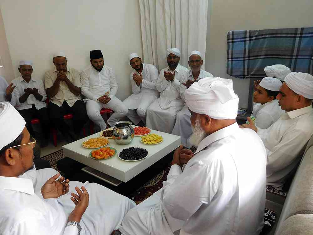 Clerics lead the prayers at Abdul Basheer's house in January. (Photo credit: TA Ameerudheen).