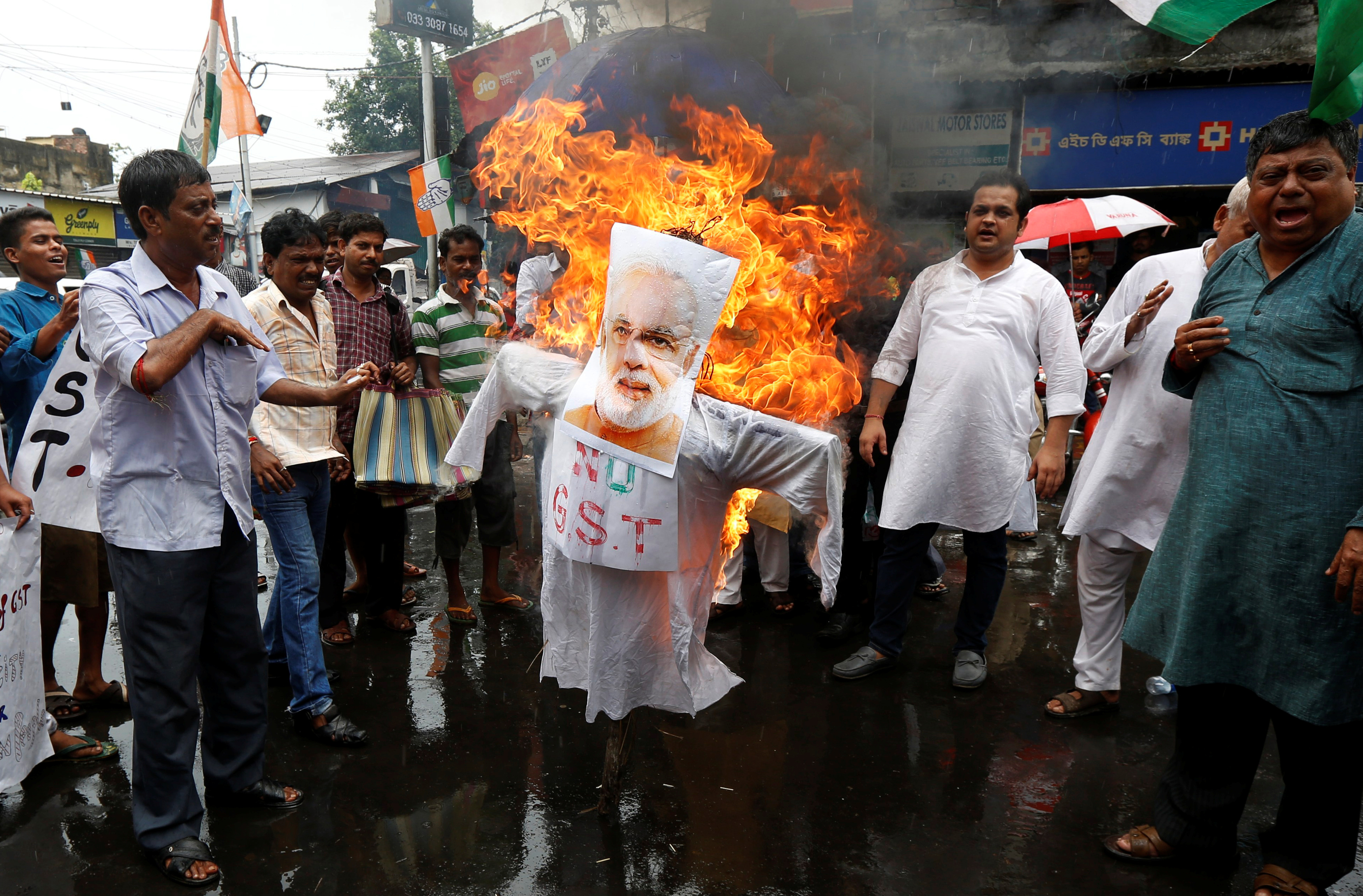 Congress supporters burn an effigy of Prime Minister Narendra Modi during a protest against the implementation of the Goods and Services Tax in Kolkata on July 2, 2017. Credit: Rupak De Chowdhuri/Reuters