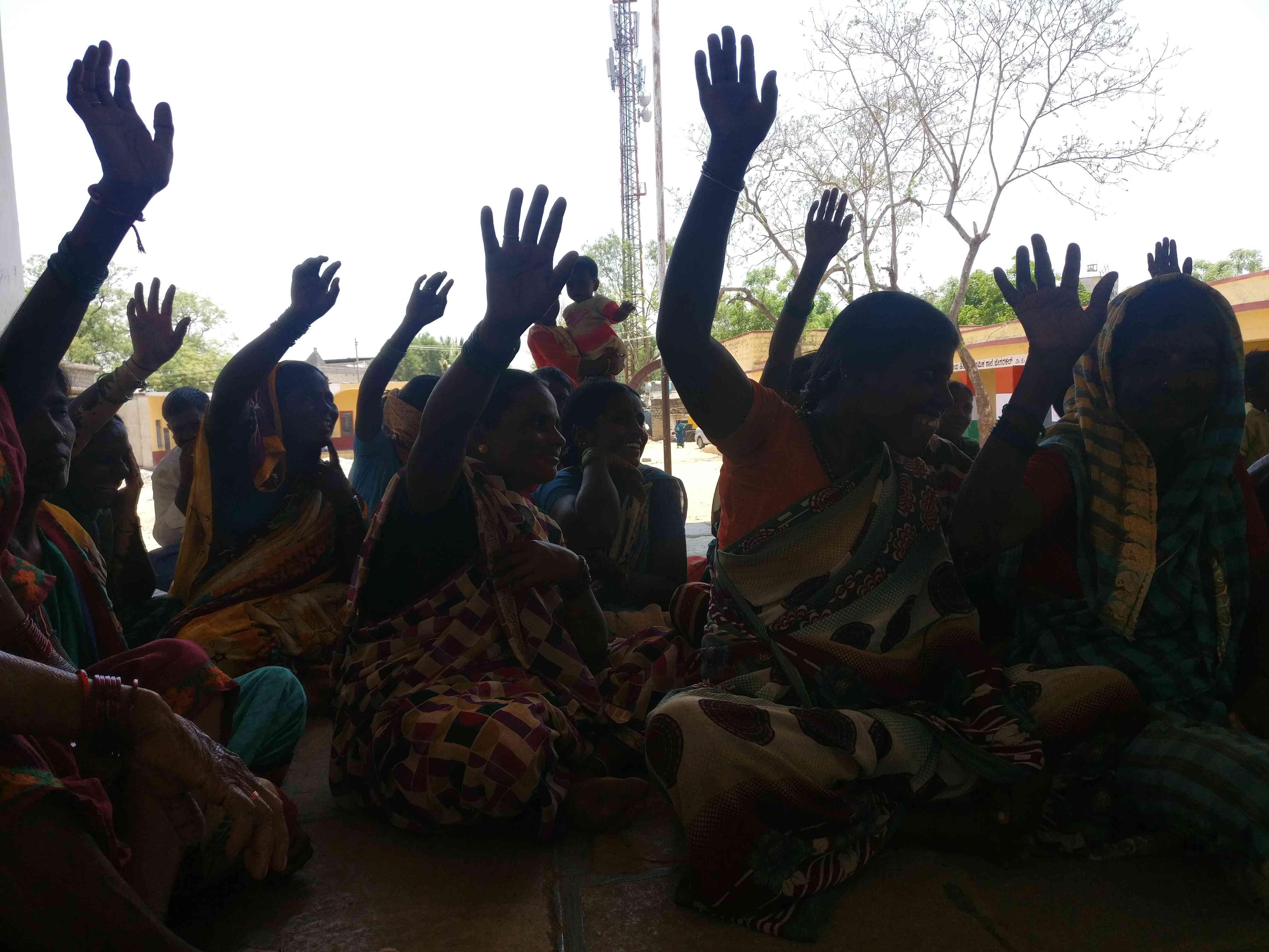 Women in Jegarkal village respond when an activist asks them how many think it is a good idea to withhold their vote to call attention to a liquor ban. Photo credit: Nayantara Narayanan