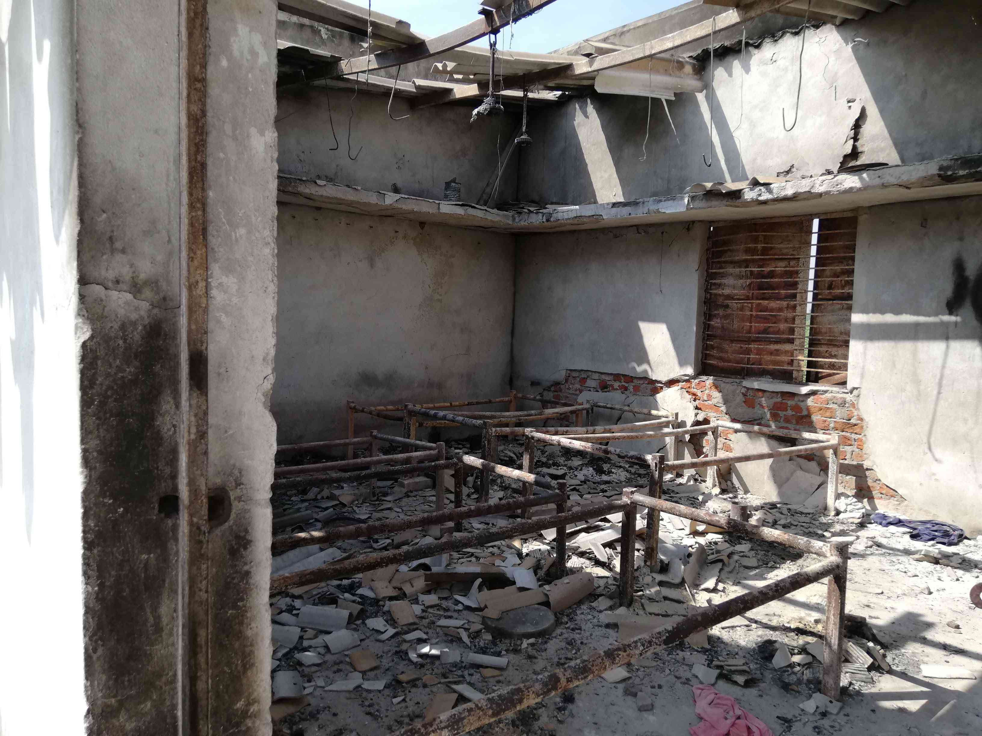A mob burnt down the living quarters of workers at the factory where the accused man was employed. The compound is now deserted. Credit: Mridula Chari