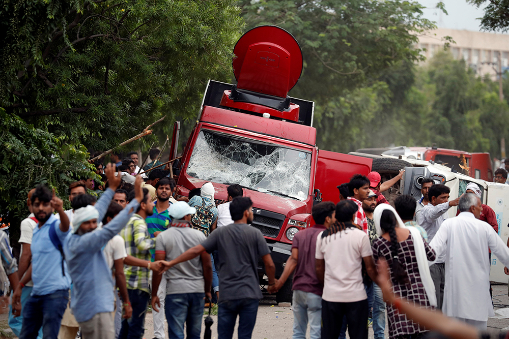 Several media staff were injured during the protests in Panchkula, where rioters attacked OB vans and set some on fire.  (Credit: Cathal McNaughton/Reuters)